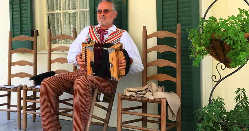 Porch musician at Vermilionville