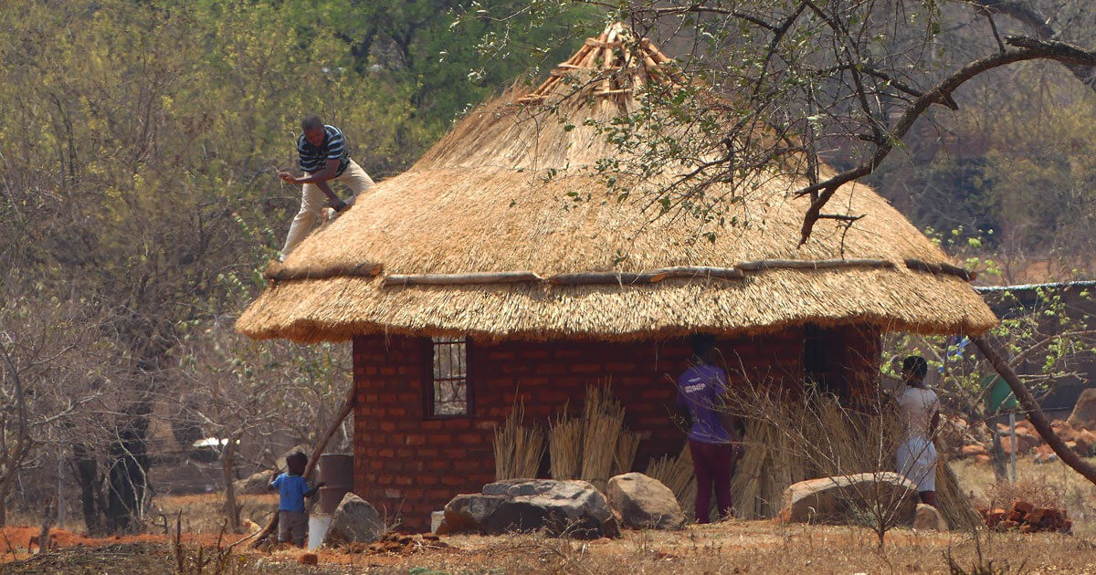 New Thatched Roof on Brick House.