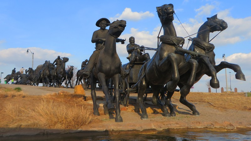 At Centennial Crossing, forty-five sculptures depict the Oklahoma Land Run.
