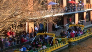 Water taxis ply the Bricktown Canal.