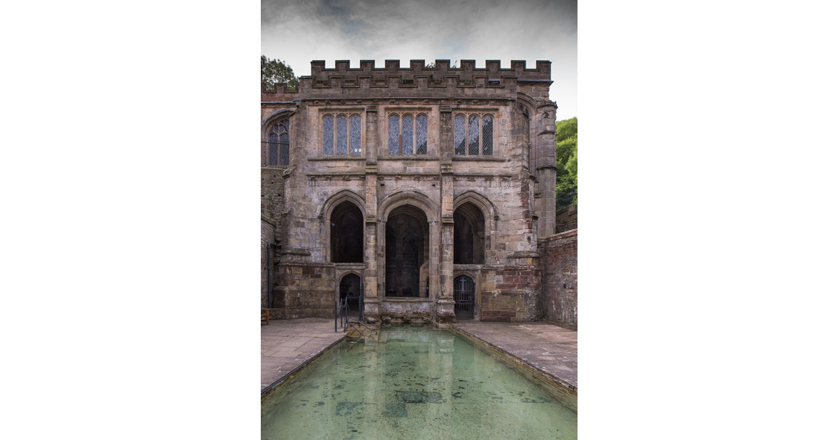 The chapel encasing St Winefride's Well was built in the sixteenth century to replace an earlier church on the site. One of its benefactors was thought to be Henry VII's mother, Lady Margaret, Countess of Richmond, whose coat of arms is one of several emblazoned on the roof bosses.