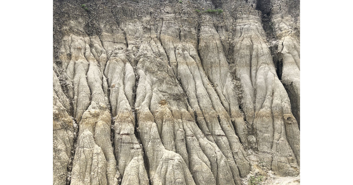 Take the Painted Canyon trails to see the rock layers.