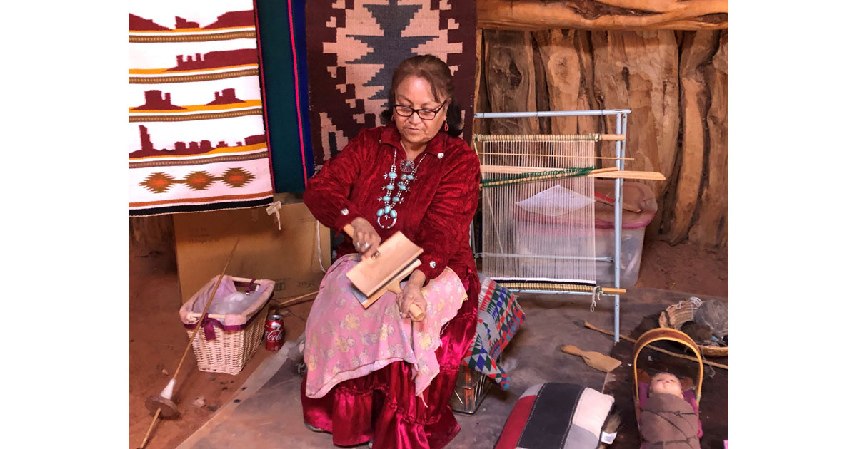 Weaving demonstration inside a traditional Hogan